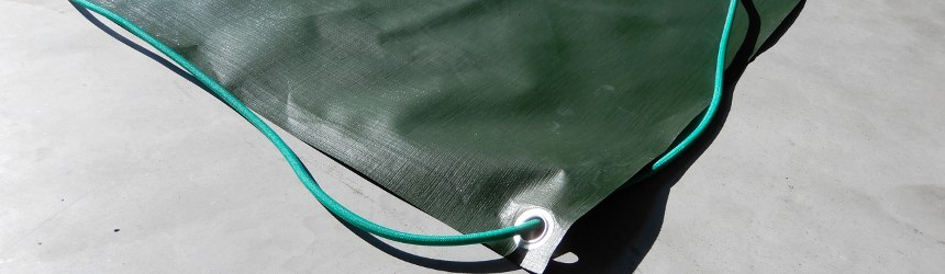 Winter pool covers with studs and elastic